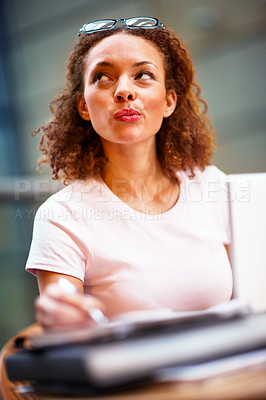 Buy stock photo Young African American business woman at work, looking away and thinking