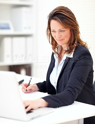 Buy stock photo Successful mature business woman at work , using a laptop
