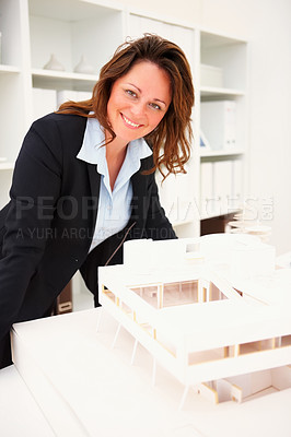 Buy stock photo Successful mature female building constructor with her new project