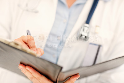 Buy stock photo Mid section of a female doctor data entering in a file