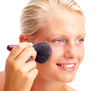 Buy stock photo Closeup portrait of a happy young woman applying make up