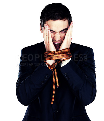 Buy stock photo Portrait of a smart young business man with tied hand against white background