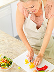 Top view of a housewife preparing salad in the kitchen