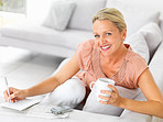 Woman enjoying coffee while finding jobs in the newspaper classi