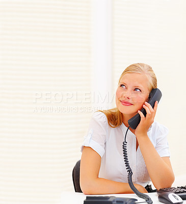 Buy stock photo Secretary using a telephone in office, looking at copy space