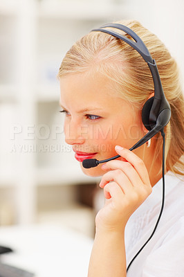 Buy stock photo Closeup of a young woman wearing headphones in office