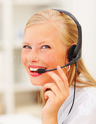 Buy stock photo Closeup of a smiling young woman wearing headphones in office