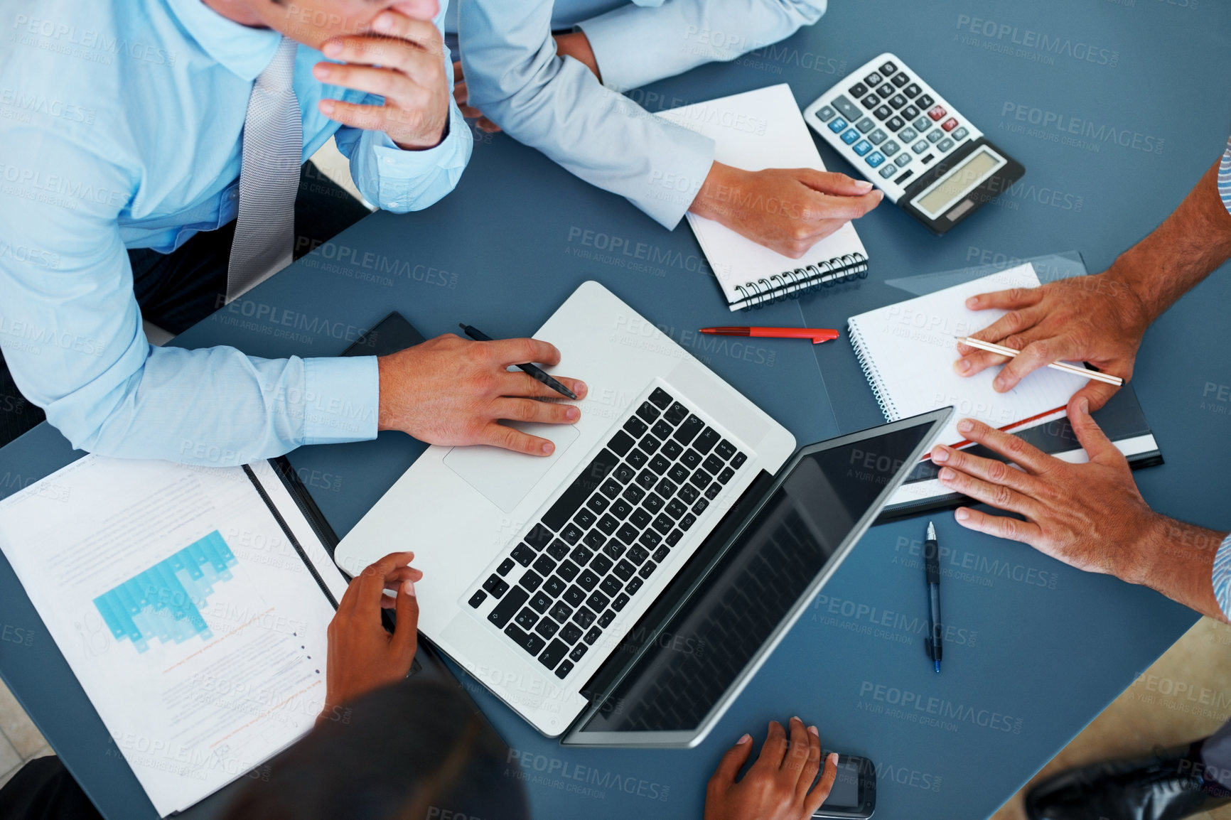 Accounting - Business people calculating budget in meeting B