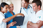 Young doctors discussing on patient's medical report