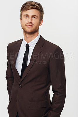 Buy stock photo Studio portrait of a stylish young businessman dressed in a suit and looking at the camera