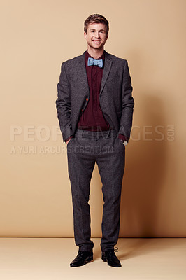 Buy stock photo Full length studio portrait of a stylishly-dressed young man smiling at the camera