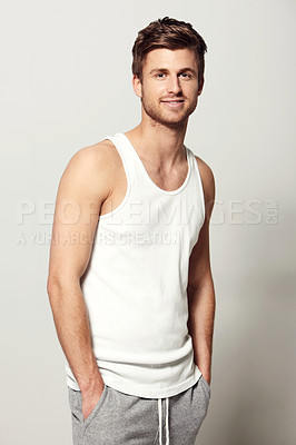 Buy stock photo Studio portrait of a casually dressed young man smiling at the camera