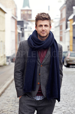 Buy stock photo Portrait of a stylishly-dressed young man standing in the street