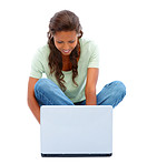Cute young female working on a laptop over white