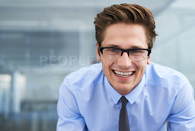 Buy stock photo A friendly young entrepreneur smiling at you alongside copyspace