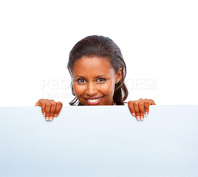 Buy stock photo Portrait of a happy African American female holding a blank billboard over white
