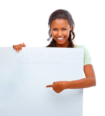 Buy stock photo Portrait of a happy young African American female pointing at an empty billboard