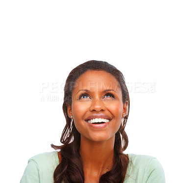 Buy stock photo Cute young African American woman looking upwards at copyspace, day dreaming