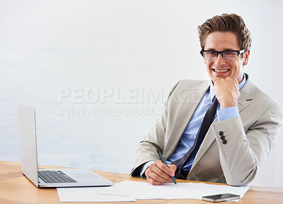 Buy stock photo Portrait of a successful young businessman sitting at his desk