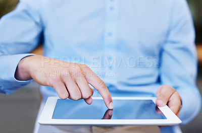 Buy stock photo Cropped image of a businessman using a digital tablet on his desk