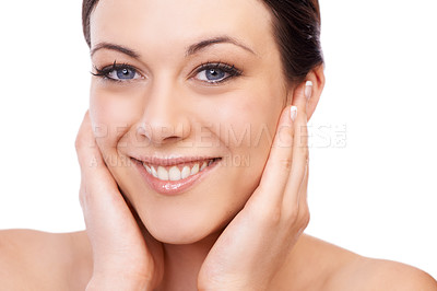 Buy stock photo A lovely young woman smiling at the camera while holding her face in her hands
