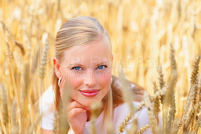 Buy stock photo Cute young female sitting in a crop field