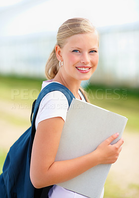Buy stock photo Portrait of a young female student carrying a bag holding a folder outdoor