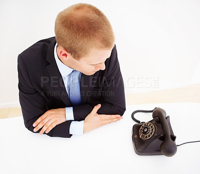 Buy stock photo Top view of businessman at desk in the office waiting for a call