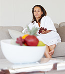 Cute woman at home eating fruits