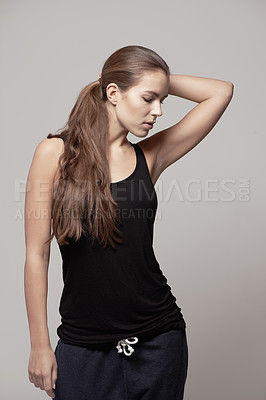 Buy stock photo Studio shot of an attractive young woman in exercise clothing