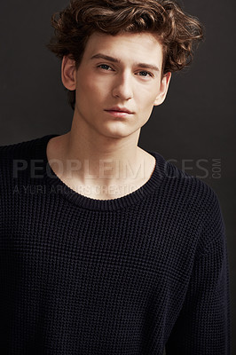 Buy stock photo Portrait of a fresh-faced young man wearing winter fashions and posing in studio