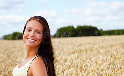 Buy stock photo Portrait of a sweet young model smiling in a crop field