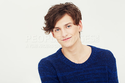 Buy stock photo Portrait of a fresh-faced young man smiling at you in studio