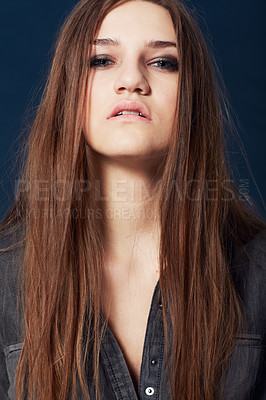 Buy stock photo A stunning model with a rebellious attitude staring you down in studio