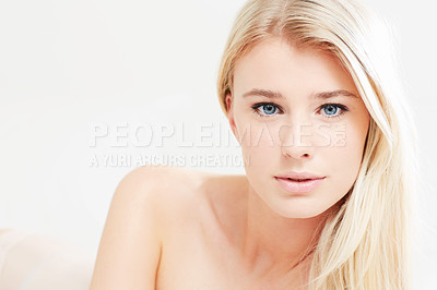 Buy stock photo A beautiful young blonde woman with bare shoulders looking at the camera - copyspace