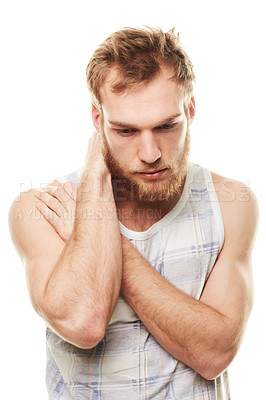Buy stock photo A young man wearing a vest and looking depressed isolated on white