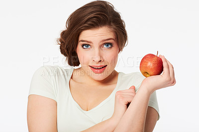 Buy stock photo Portrait of a pretty brunette woman holding a red apple