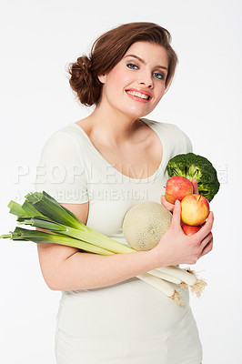 Buy stock photo Pretty brunette woman holding healthy veggies while isolated on white