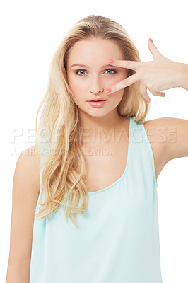 Buy stock photo A pretty young blond woman running her fingers over her eyes while isolated on a white background
