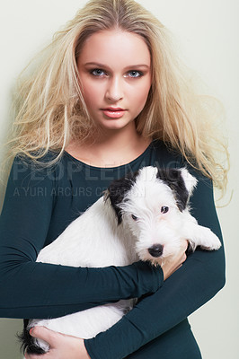 Buy stock photo Portrait of a gorgeous young woman holding her adorable dog