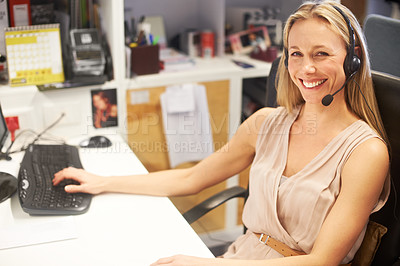 Buy stock photo Cropped portrait of a smiling businesswoman wearing a headset at her desk