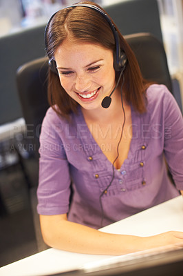 Buy stock photo Cropped shot of a young businesswoman wearing a headset at her desk