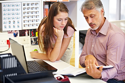 Buy stock photo Cropped shot of mature businessman assisting a female coworker