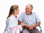 Happy nurse with a smiling senior man sitting on chair
