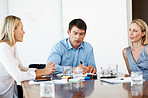 Team of professionals discussing plan in conference room