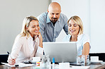 Confident young executives working on laptop