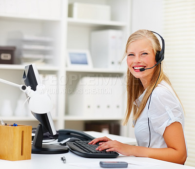 Buy stock photo Pretty happy woman working on computer and wearing headphones