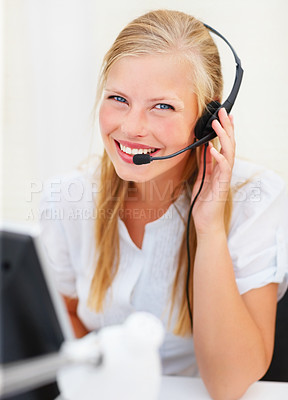 Buy stock photo Cute young blond business woman working on a headset
