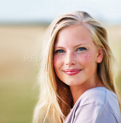 Buy stock photo Pretty young blond female smiling while outdoors