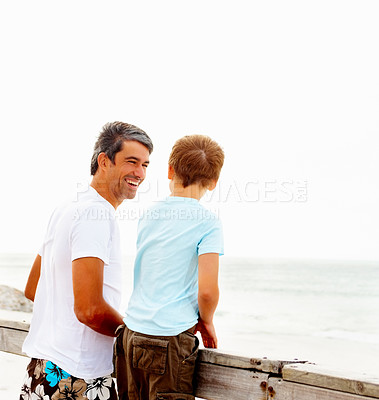 Buy stock photo Happy father and son a beach vacation enjoying by the a wooden railing
